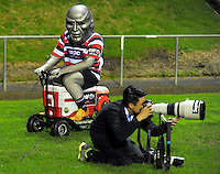 Steely Dan rides past Getty Images photographer Anthony Au-Yeung during the Mitre 10 Cup national provincial championship Jonah Lomu Trophy Memorial Match between the Counties Manukau Steelers and Wellington Lions at Ecolight Stadium, Pukekohe, Auckland, New Zealand on Friday, 9 September 2016. Photo: Dave Lintott / lintottphoto.co.nz
