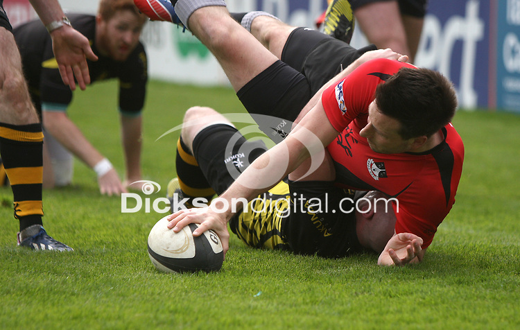 2014 McCAMBLEY CUP FINAL - Ards 4 vs Cookstown | Saturday 26th April 2014<br /> <br /> Ards winger Andrew Todd does well to smash his way over in the corner to score despite being tackled by Cookstown centre Kevin Nugent during the 2014 McCambley Cup Final between Ards 4's and Cookstown at Ravenhill Stadium, Belfast.<br /> <br /> Mandatory Credit - Photo by John Dickson - DICKSONDIGITAL