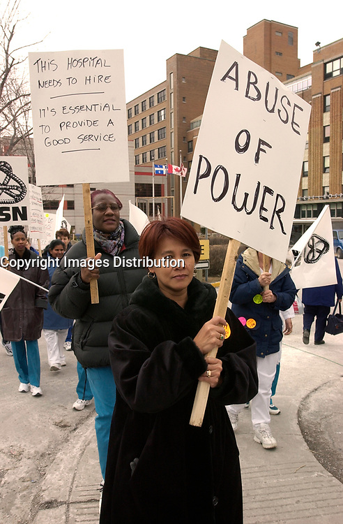 March 12th, 2002, Montreal, Quebec, Canada; <br /> <br /> Employees protest their working condition, low wage and work overload  imposed by the budget cuts,in front of the Montreal Jewish Hospital , March 12, 2002<br /> <br /> (Mandatory Credit: Photo by Sevy - Images Distribution (©) Copyright 2002 by Sevy<br /> <br /> NOTE :  D-1 H original JPEG, saved as Adobe 1998 RGB