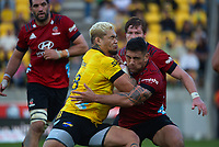 Alex Fidow runs into Codie Taylor during the Super Rugby Aotearoa match between the Hurricanes and Crusaders at Sky Stadium in Wellington, New Zealand on Sunday, 11 April 2020. Photo: Dave Lintott / lintottphoto.co.nz