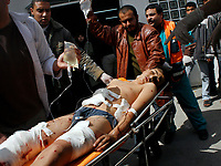 "Palestinian medics carry a man wounded during an Israeli army operation in the northern Gaza Strip, into hospital in Beit Lahiya, Saturday, March 1, 2008. Thirty-three Gazans, including at least 16 civilians, died in Israeli-Palestinian violence that escalated sharply Saturday, clouding an upcoming peacemaking mission by U.S. Secretary of State Condoleezza Rice. Two children were among those killed in some of the fiercest fighting in the Gaza Strip since Islamic Hamas militants seized control there in June. The latest round of clashes, which began Wednesday, has renewed threats of an Israeli invasion of Gaza to crush militant rocket squads that bombard southern Israel daily.""photo by Fady Adwan"""