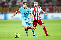 Harry Winks of Tottenham Hotspur in action with Mathieu Valbuena of Olympiacos Fc, during the UEFA Champions League match between Olympiacos Fc and Tottenham Hotspur, in Karaiskaki Stadium in Piraeus, Greece. Wednesday 18 September 2019