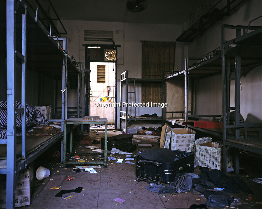"""Ransacked and desterted dormitories in Dingfu Factory in Houjie Town, Donguan, China.  A sign outside the factory that made shoes for Zara and Nine West amongst others, reads that the """"Donguan People's Court have closed the factory"""" .  As the economy changes and Chinese labour gets more expensive, factories are cosing leaving ghost towns behind them.<br /><br />MUST CREDIT PHOTO BY RICHARD JONES/SINOPIX"""