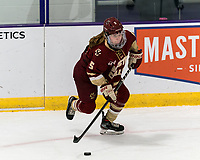 WORCESTER, MA - JANUARY 16: Savannah Norcross #5 of Boston College brings the puck forward during a game between Boston College and Holy Cross at Hart Center Rink on January 16, 2021 in Worcester, Massachusetts.