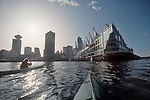 Vancouver; Canada Place, Cruise Ship Terminal, British Columbia; Canada; women sea kayaker; Burrard Inlet; skyline from the water, 2002