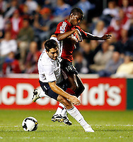 US midfielder Clint Dempsey (8) is fouled by Trinidad & Tobago forward Anthony Wolfe (14).  The U.S. Men's National Team defeated Trinidad & Tobago 3-0 at Toyota Park in Bridgeview, IL on September 10, 2008.