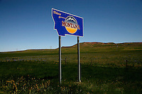 """A sign that says """"Welcome to Montana"""" stands at the border between Montana and South Dakota."""