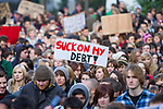 """© Joel Goodman - 07973 332324 . 24/11/2010 . Manchester , UK . Placard reading """" Suck on my debt """" . Students and their supporters march and demonstrate through Manchester City Centre against government cuts to student support and rising education fees , specifically against an election pledge made by the Liberal Democrats prior to forming the coalition government . Photo credit : Joel Goodman"""