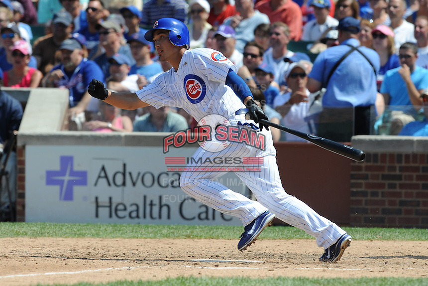 Chicago Cubs second baseman Darwin Barney #15  swings at a pitch during a game against the Arizona Diamondbacks at Wrigley Field on July 15, 2012 in Chicago, Illinois. The Cubs defeated the Diamondbacks 3-1. (Tony Farlow/Four Seam Images).