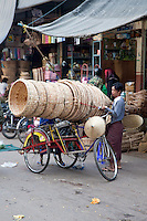Myanmar, Burma, Mandalay.  Market Scene, Man with Tricycle Cart and Baskets.