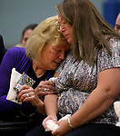 Peggy Eddington-Smith, left, hugs Donna Gregory during a ceremony, in Dayton, Nev., on Saturday, Sept. 20, 2013. After Gregory's 14 years of searching for relatives of World War II Private John F. Eddington, the medal and other personal items, found in Missouri, were returned to Eddington-Smith. <br /> Photo by Cathleen Allison/Las Vegas Review-Journal