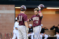 Designated hitter Bradley Jones (13) of the College of Charleston Cougars is congratulated by Erven Roper (17) after hitting a home run in the seventh inning of a game against the University of South Carolina Upstate Spartans on Tuesday, March 31, 2015, at Cleveland S. Harley Park in Spartanburg, South Carolina. Charleston won, 10-0. (Tom Priddy/Four Seam Images)
