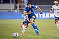 SAN JOSE, CA - MAY 01: Cristian Espinoza #10 of the San Jose Earthquakes dribbles the ball during a game between San Jose Earthquakes and D.C. United at PayPal Park on May 01, 2021 in San Jose, California.