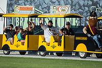 Chase McDonald (34) of the Sussex County Miners waves to fans as he rides the train around the warning track prior to the game against the New Jersey Jackals at Skylands Stadium on July 29, 2017 in Augusta, New Jersey.  The Miners defeated the Jackals 7-0.  (Brian Westerholt/Four Seam Images)