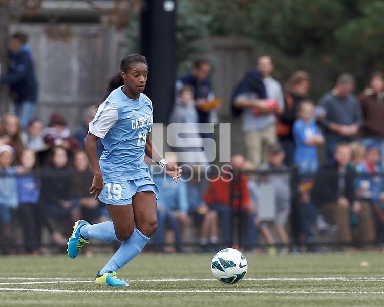 University of North Carolina midfielder Crystal Dunn (19) at midfield.   University of North Carolina (blue) defeated Boston College (white), 1-0, at Newton Campus Field, on October 13, 2013.