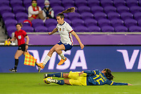 ORLANDO, FL - JANUARY 18: Kelley O'Hara #5 of the USWNT jumps over Orianica Velasquez #15 of Colombia during a game between Colombia and USWNT at Exploria Stadium on January 18, 2021 in Orlando, Florida.