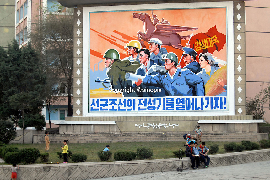 """Propaganda poster in Pyongyang, North Korea. The DPRK (Democratic People's Republic of Korea) is the last great dictatorship where the people are bombarded with images of the """"Eternal President"""" Kim Il-sung who died in 1994  and his son and current leader Kim Jong-il who are worshipped like a God."""