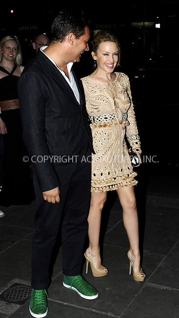 WWW.ACEPIXS.COM . . . . .  ..... . . . . US SALES ONLY . . . . .....April 6 2011, London....Kylie Minogue and William Baker at 'The Hurly Burly Show' directed by William Baker at the Garrick Theatre on April 6, 2011 in London, England....Please byline: FAMOUS-ACE PICTURES... . . . .  ....Ace Pictures, Inc:  ..Tel: (212) 243-8787..e-mail: info@acepixs.com..web: http://www.acepixs.com