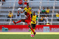 July 16th 2021; Orlando, Florida, USA; Jamaica defender Liam Moore and Guadeloupe forward Dimitri Ramothe challenge for the high ball during the Concacaf Gold Cup match between Guadeloupe and Jamaica on July 16, 2021 at Exploria Stadium in Orlando, Fl.