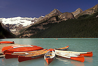 AJ3638, Banff National Park, canoe, Lake Louise, Alberta, Canada, Canadian Rockies, Rocky Mountains, Red and white canoes moored on the dock on beautiful Lake Louise with the snow-capped mountains in the distance in Banff National Park in the province of Alberta.