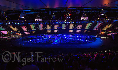 """12 AUG 2012 - LONDON, GBR - Lights flash around the stadium during the """"A Symphony of British Music"""" section of the London 2012 Olympic Games Closing Ceremony in the Olympic Stadium in the Olympic Park, Stratford, London, Great Britain .(PHOTO (C) 2012 NIGEL FARROW)"""