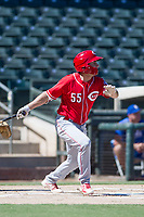 Cincinnati Reds second baseman Alejo Lopez (55) follows through on his swing during an Instructional League game against the Kansas City Royals on October 2, 2017 at Surprise Stadium in Surprise, Arizona. (Zachary Lucy/Four Seam Images)