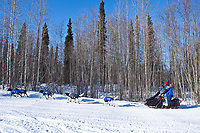 Gerald Sousa runs on the wide trail leaving the Galena checkpoint during the 2010 Iditarod