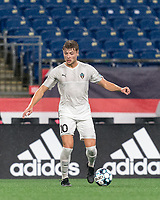 FOXBOROUGH, MA - SEPTEMBER 1: Charlie Dennis #10 of FC Tucson dribbles at midfield during a game between FC Tucson and New England Revolution II at Gillette Stadium on September 1, 2021 in Foxborough, Massachusetts.