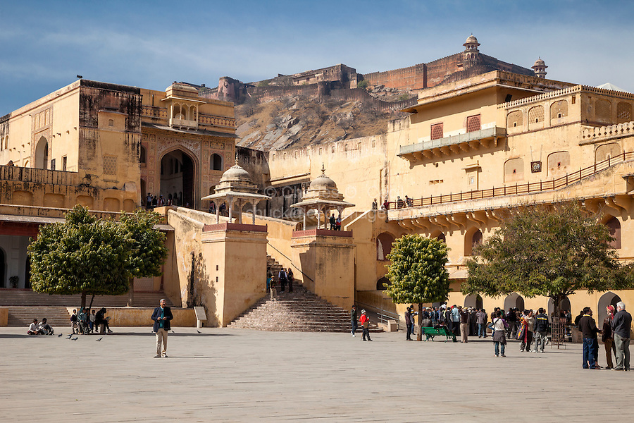 Jaipur, Rajasthan, India.   Main Courtyard of the Amber Palace.  Jaigarh Fort on the hilltop in the background.