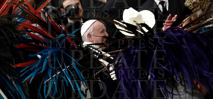 Papa Francesco saluta un gruppo di persone provenienti dal Messico vestite con il costume tradizionale al termine dell'Udienza Generale del mercoledi' in aula Paolo VI, Citta' del Vaticano, 7 dicembre 2016.<br /> Pope Francis greets a group of people from Mexico dressed in traditional Mexican outfits  during his weekly general audience in Paul VI Hall at the Vatican on December 7, 2016. <br /> UPDATE IMAGES PRESS/Isabella Bonotto<br /> <br /> STRICTLY ONLY FOR EDITORIAL USE