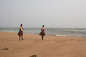 Ghana - Fuveme - Schoolgirls look at the ocean while the tide is quickly rising.<br /> <br /> Nestled between the ocean and the Volta river estuary, the village of Fuvemeh has seen its territory reduced from several kilometers to few hundred meters. Nowadays, the villages sits on a narrow strip of land which separates the coastline from the adjacent lagoon. Haunted by coastal erosion, its 1,000 inhabitants have literally nowhere to move.