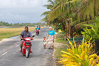 Local people use a road that runs along the side of the airport runway, in central Funafuti. Located in the South West Pacific Ocean, Tuvalu is the world's 4th smallest country and is one of the most vulnerable to climate change impacts including sea level rise, drought and extreme weather events. Tuvalu - March, 2019.