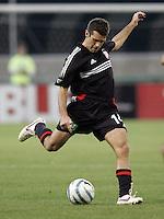 7 May 2005.  DC United's Ben Olsen (14) shoots the ball at RFK Stadium in Washington, DC.
