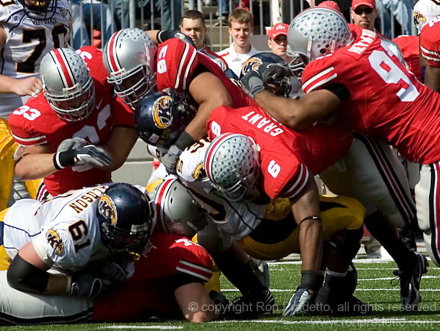 The Ohio State defense gang tackles a Kent State runner October 13, 2007.