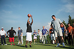 Allen Iverson (left) plays basketball while Yao Ming watches at the 17th hole during the World Celebrity Pro-Am 2016 Mission Hills China Golf Tournament on 22 October 2016, in Haikou, China. Photo by Weixiang Lim / Power Sport Images