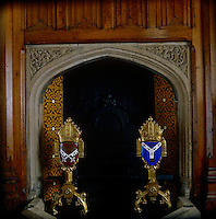 A fireplace in the Bishop's Robing Room, flanked by ecclesiastical firedogs