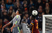 Calcio, andata degli ottavi di finale di Champions League: Roma vs Real Madrid. Roma, stadio Olimpico, 17 febbraio 2016.<br /> From left, Real Madrid's Cristiano Ronaldo and Karim Benzema and Roma's Antonio Ruediger jump for the ball during the first leg round of 16 Champions League football match between Roma and Real Madrid, at Rome's Olympic stadium, 17 February 2016.<br /> UPDATE IMAGES PRESS/Riccardo De Luca