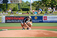 The grounds crew works on the pitchers mound before the Salt Lake Bees game against the Fresno Grizzlies in Pacific Coast League action at Smith's Ballpark on June 13, 2015 in Salt Lake City, Utah.  (Stephen Smith/Four Seam Images)