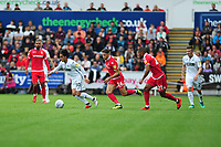 Yan Dhanda of Swansea City vies for possession with Matty Cash of Nottingham Forest during the Sky Bet Championship match between Swansea City and Nottingham Forest at the Liberty Stadium, in Swansea, Wales, UK. Saturday 15 September 2018