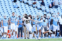CHAPEL HILL, NC - NOVEMBER 14: Taylor Morin #83 of Wake Forest is grabbed by Rontavius Toe Groves #4 of North Carolina while trying to catch a pass during a game between Wake Forest and North Carolina at Kenan Memorial Stadium on November 14, 2020 in Chapel Hill, North Carolina.