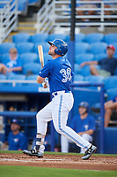 Dunedin Blue Jays right fielder Chad Spanberger (30) follows through on a swing during a game against the Jupiter Hammerheads on August 14, 2018 at Dunedin Stadium in Dunedin, Florida.  Jupiter defeated Dunedin 5-4 in 10 innings.  (Mike Janes/Four Seam Images)
