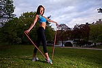 Young Woman skipping rope and working out in Central Park, New York City