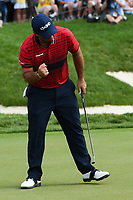 6th June 2021; Dublin, Ohio, USA; Patrick Reed (USA) gives a fist bump after sinking his birdie putt on 18 during the Memorial Tournament final round at Muirfield Village Golf Club