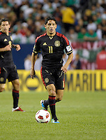 Mexico's Angel Reyna dribbles the ball.  Mexico defeated Costa Rica 4-1 at the 2011 CONCACAF Gold Cup at Soldier Field in Chicago, IL on June 12, 2011.