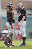 Catcher Dashenko Ricardo #44 of the Bluefield Orioles chats with pitcher Robert Holloway #29 at Howard Johnson Field August 1, 2009 in Johnson City, Tennessee. (Photo by Brian Westerholt / Four Seam Images)