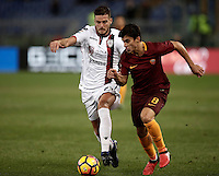 Calcio, Serie A: Roma vs Cagliari, Roma, stadio Olimpico, 22 gennaio 2017.<br /> Cagliari's Luca Ceppitelli, left, in action with Roma's Diego Perotti, right, during the Italian Serie A football match between Roma and Cagliari at Rome's Olympic stadium, 22 January 2017. <br /> UPDATE IMAGES PRESS/Isabella Bonotto
