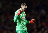 Manchester United goalkeeper David De Gea celebrates the opening goal during the Barclays Premier League match between Manchester United and Swansea City played at Old Trafford, Manchester on January 2nd 2016