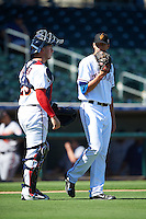 Surprise Saguaros catcher Mitch Garver (23), of the Minnesota Twins organization, talks with pitcher Brett Martin (27), of the Texas Rangers organization, during a game against the Peoria Javelinas on October 20, 2016 at Surprise Stadium in Surprise, Arizona.  Peoria defeated Surprise 6-4.  (Mike Janes/Four Seam Images)