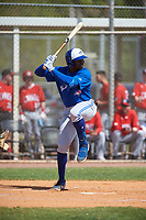 Toronto Blue Jays Demi Orimoloye (48) bats during an exhibition game against the Canada Junior National Team on March 8, 2020 at Baseball City in St. Petersburg, Florida.  (Mike Janes/Four Seam Images)