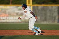 Oscar Serratos (13) (Biola) of the Burlington Sock Puppets takes his lead off of first base against the Danville Otterbots at Burlington Athletic Park on June 5, 2021 in Burlington, North Carolina. (Brian Westerholt/Four Seam Images)